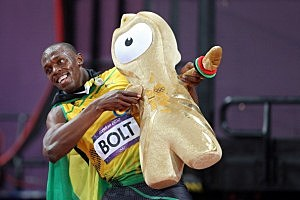 Usain Bolt of Jamaica celebrates winning gold with a Wenlock mascot in the Men's 100m Final
