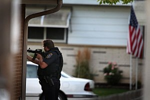 Police secure a neighborhood where the gunman lived who is suspected of opening fire at the Sikh Temple of Wisconsin