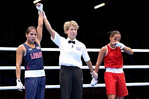 Marlen Esparza (Blue) of the United States celebrates after defeating Karlha Magliocco (RED) of Venezuela in the Women's Fly (51kg) Boxing Quarterfinals