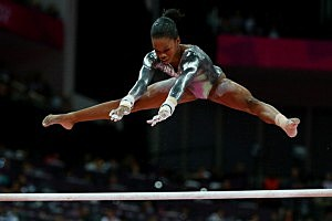 Gabrielle Douglas of the United States competes in the Artistic Gymnastics Women's Uneven Bars final