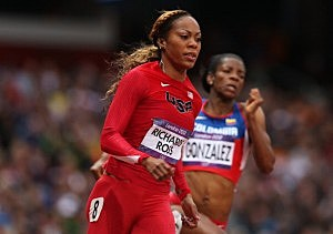 Sanya Richards-Ross of the United States runs alongside Norma Gonzalez of Colombia in the Women's 200m heat