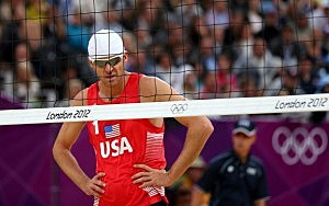 Jacob Gibb (playing partner of Sean Rosenthal) of the United States looks on dejected against Martins Plavins and Janis Smedins of Latvia during the Men's Beach Volleyball quarterfinal match