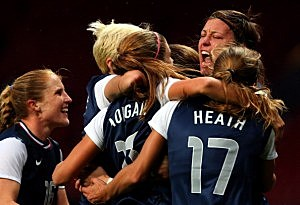 Alex Morgan #13 of the United States celebrates with her teammates after scoring the winning goal in extra time during the Women's Football Semi Final match