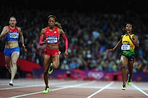 Sanya Richards-Ross of the United States leads Aleksandra Fedoriva of Russia and Shelly-Ann Fraser-Pryce of Jamaica in the Women's 200m Semifinals