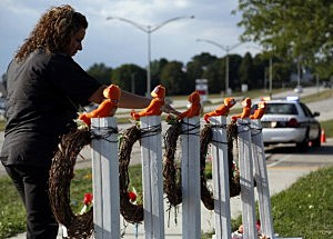 Mourners visit a make shift memorial near the Sikh Temple of Wisconsin