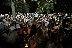 Mourners and supporters of the Sikh Temple of Wisconsin attend a candle light vigil held at the Oak Creek Community Center on the National Night Out event