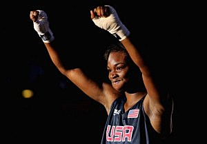 Claressa Shields of the United States celebrates her victory against Marina Volnova of Kazakhstan during the Women's Middle (75kg) Boxing semifinals
