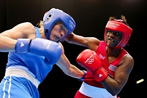 punches with Nadezda Torlopova (L) of Russia during the Women's Middle (75kg) Boxing