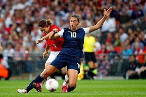 Carli Lloyd #10 of United States and Nahomi Kawasumi #9 of Japan battle for the ball i