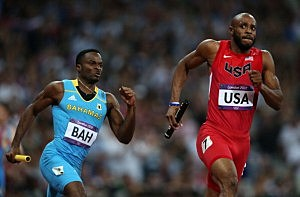 Ramon Miller (L) of the Bahamas and Angelo Taylor of the United States compete during the Men's 4 x 400m Relay Final