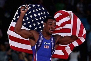 Jordan Ernest Burroughs of the United States celebrates his gold medal in the Men's Freestyle 74 kg Wrestling