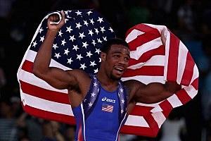 Jordan Ernest Burroughs of the United States celebrates his gold medal in the Men's Freestyle 74 kg Wrestling