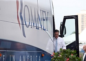 Mitt Romney (C) arrives at the USS Wisconsin in Norfolk, Virginia