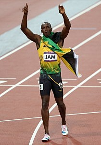 Usain Bolt of Jamaica celebrates winning gold and setting a new world record of 36.84 during the Men's 4 x 100m Relay Final