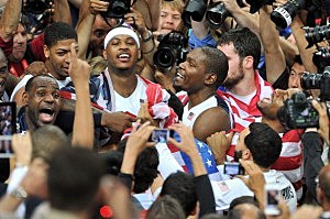 LeBron James #6, Carmelo Anthony #15 and Kevin Durant #5 of the United States celebrate after they won against Spain during the Men's Basketball gold medal game