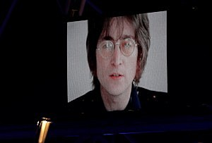 John Lennon is displayed on a screen inside the stadium during the Olympics Closing Ceremony