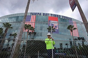 J.J. Dutton from the Smith Fence company works on putting up a security fence around the Tampa Bay Times Forum