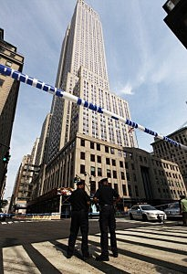 New York Police officers stand at the scene of a shooting near the Empire State Building