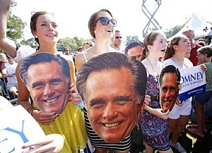 Mitt Romney supporters with Romney masks.