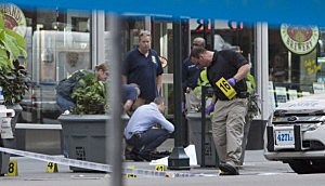 New York Police mark bullet casings beside the body of 58-year-old Jeffrey Johnson near the Empire State Building