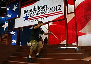 A worker sweeps the steps of the stage ahead of the Republican National Convention at the Tampa Bay Times Forum
