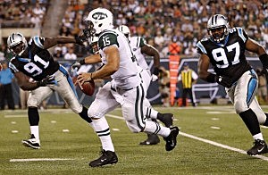 Tim Tebow rolls out against the Carolina Panthers