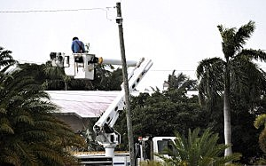 A Monroe County Utility worker repairs power lines after Tropical Storm Isaac moved through the Florida Keys