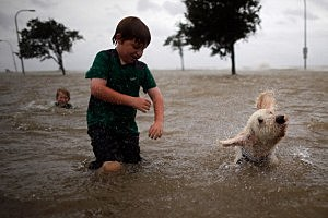 oshua Keegan and his dog Scout swim in the rising water of Lake Pontchartrain