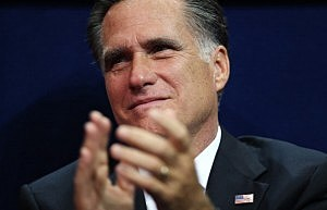 Mitt Romney listens to Governor Christie deliver the keynote address at the Republican National Convention.