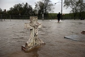 A flooded cemetery in Oakville, Plaquemines Parish, Louisiana