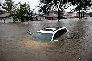 A car sits submerged in the flood waters of Hurricane Isaac in the River Forest in LaPlace, Louisiana