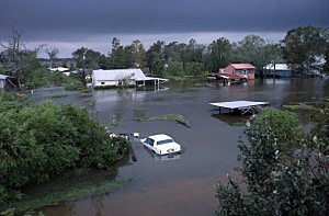 Property remains partially submerged by Hurricane Isaac's flood waters on August 30, 2012 in Manchac, Louisiana