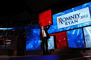 Mitt Romney waves on stage after accepting the Republican nomination for President