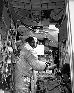 Neil Armstrong in training in a lunar module simulator