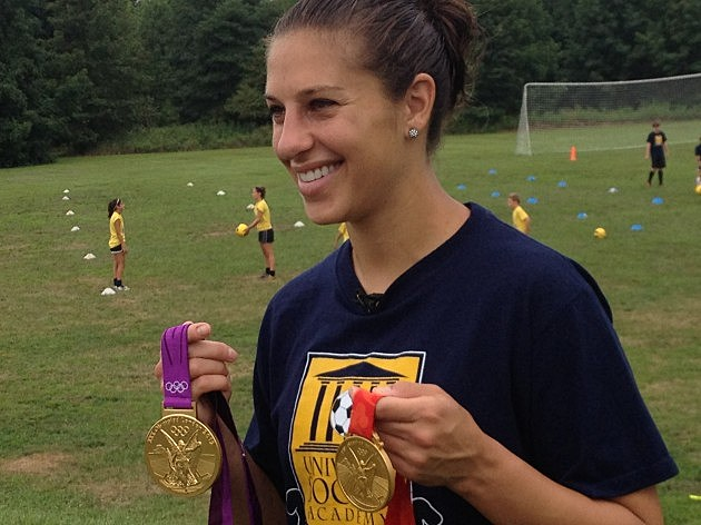 Carli Lloyd shows off her Olympic gold medals