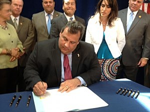 Governor Christie signs the teacher tenure reform bill