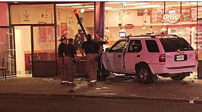 SUV crashes into Jersey City Dunkin' Donuts (WPIX TV)
