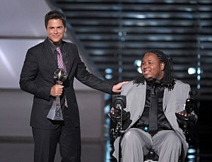 Actor Rob Lowe presents Eric LeGrand the Jimmy V Award for perseverance during The ESPY Awards in July.