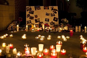 Candles burn in front of a memorial at Old Bridge High School