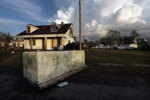 A casket is dislodged from a cemetery and rests in front of a house in Plaquemines Parish, Louisiana