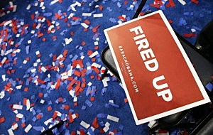 Signs and confetti sit on the floor after the Democrat National Convention