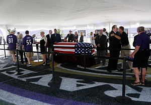 Fans view the casket of former Baltimore Ravens owner Art Modell during a silent tribute at M&T Bank Stadium
