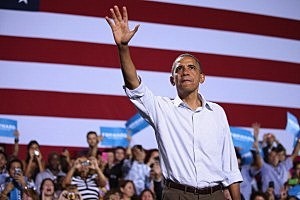 President Barack Obama waves to supporters at a campaign rally in Kissimmee, Florida