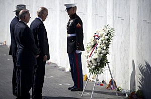 Vice President Joseph Biden (3L) lays a wreath with Secretary of the Interior Ken Salazar in front of the Wall of Names at the Flight 93 National Memorial