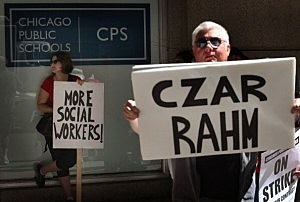 Chicago public school teachers and their supporters picket in front of the Chicago Public Schools (CPS) headquarters