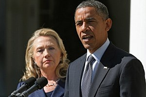 President Barack Obama and Secretary of State Hillary Clinton make a statement about the death of U.S. ambassador to Libya J. Christopher Stevens in the Rose Garden at the White House