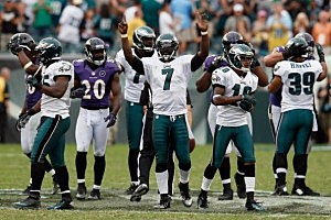 Michael Vick celebrates after the Eagles defeated the Baltimore Ravens 24-23