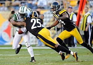 Santonio Holmes can't hold onto the ball after being hit by Ryan Clark of the Pittsburgh Steelers