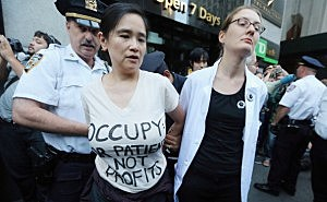 Laurie Wen, with Physicians for a National Health Program (L) and Dr. Magni Hamso, MD, both affiliated with Occupy Wall Street, are arrested in the Financial District while protesting Wall Street influence in health care