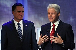 Former U.S. President Bill Clinton (R) and Mitt Romeny at the Clinton Global Initiative